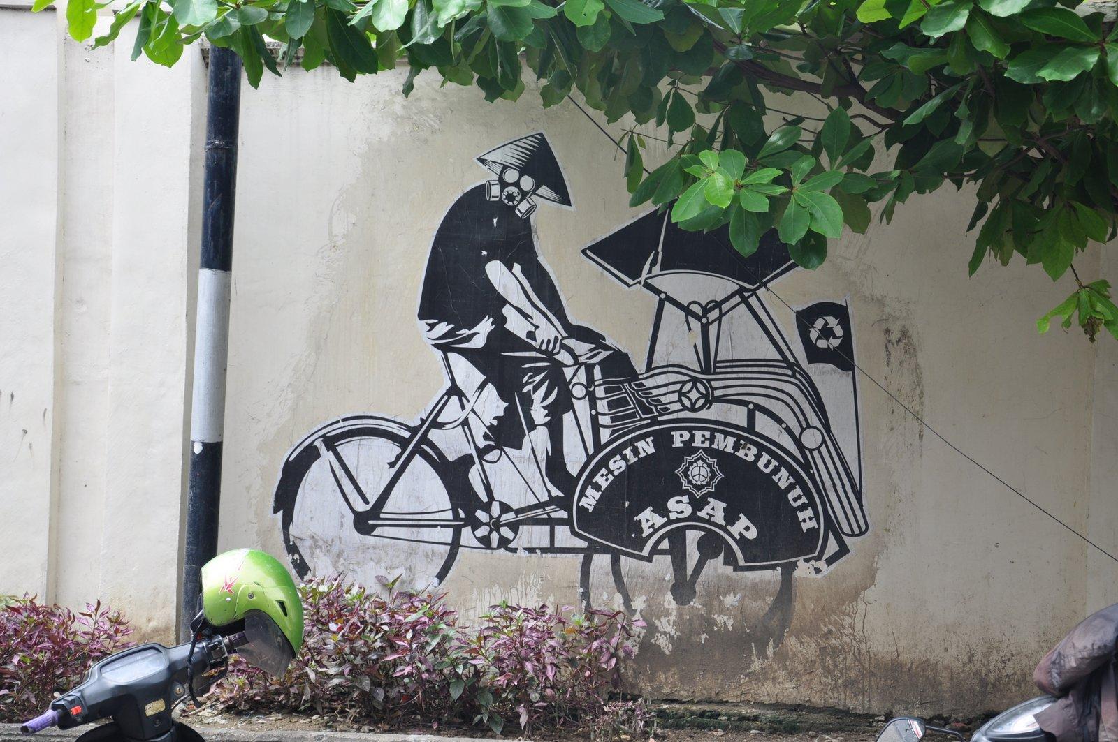 Une fresque de street-art qui dénonce les dangers de la pollution et défend l'usage des becaks écolos